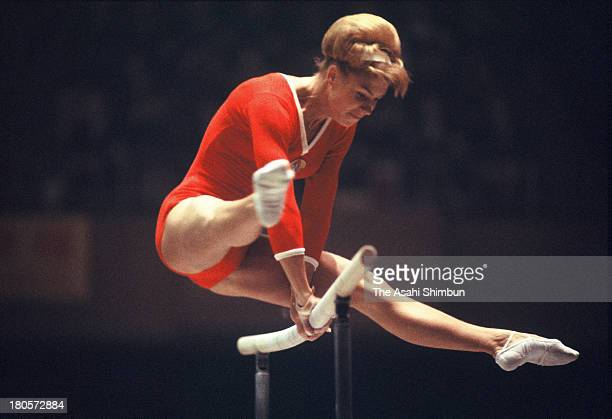 Larysa Latynina of Soviet Union competes in the Uneven Bars of the Women's Artistic Gymnastics Individual AllAround during the Tokyo Olympics at...
