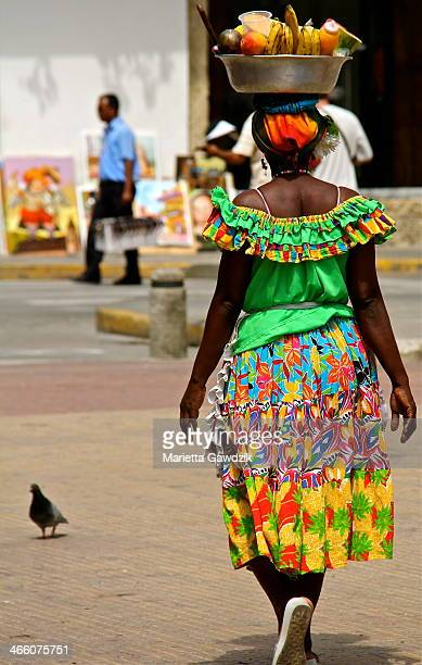 Las Palenqueras are the famous ladies - fruit vendors, dressed in vibrant colours carrying fruit baskets on their head. They are from the city of San...