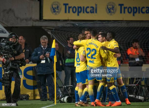 Las Palmas' Argentinian forward Jonathan Calleri celebrates with teammates after scoring during the Spanish league football match UD Las Palmas vs FC...
