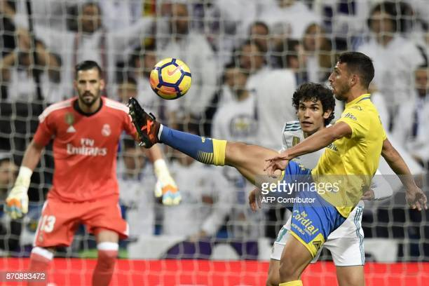Las Palmas' Argentinian forward Jonathan Calleri challenges Real Madrid's Spanish defender Jesus Vallejo during the Spanish league football match...