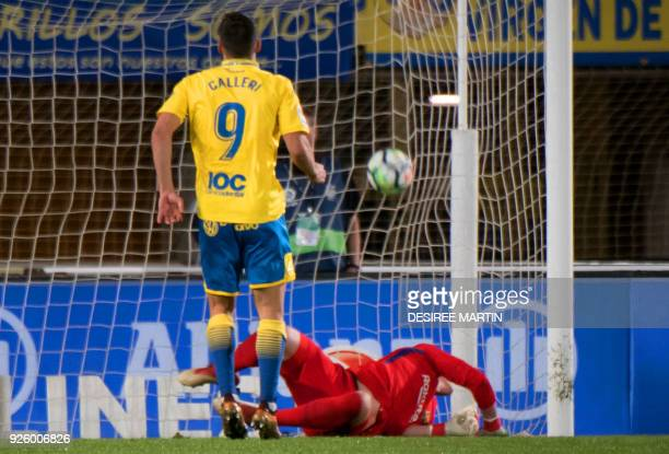 Las Palmas' Argentinian forward Jonathan Calleri scores a penalty shot against Barcelona's German goalkeeper MarcAndre Ter Stegen during the Spanish...