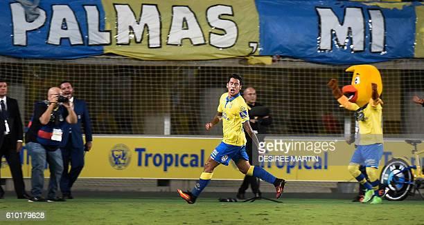 Las Palmas' Argentinian forward Sergio Araujo celebrates a goal during the Spanish league football match UD Las Palmas vs Real Madrid CF at the Gran...