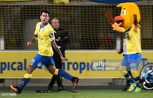 Las Palmas' Argentinian forward Sergio Araujo celebrates a goal during the Spanish league football match UD Las Palmas vs Real Madrid CF at the Gran...