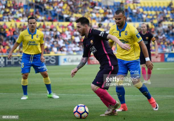 Las Palmas' forward Jese vies with Barcelona's Argentinian forward Lionel Messi during the Spanish league football match UD Las Palmas vs FC...