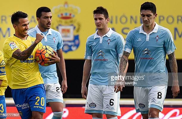 Las Palmas' forward Jonathan Viera celebrates a goal next to Celta Vigo's Chilean midfielder Pablo Hernandez and Celta Vigo's Serbian midfielder...