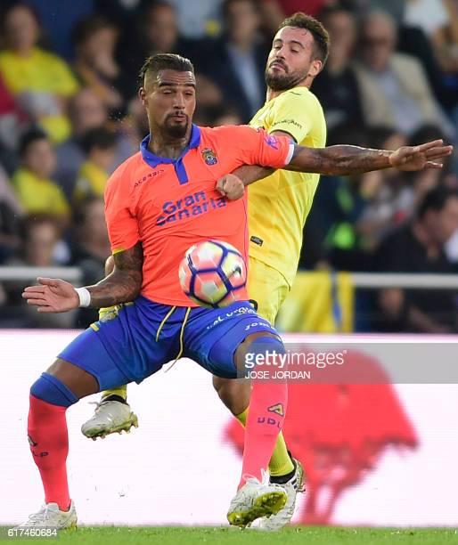 Las Palmas' GermanGhanaian midfielder KevinPrince Boateng vies with Villarreal's defender Mario during the Spanish league football match between...