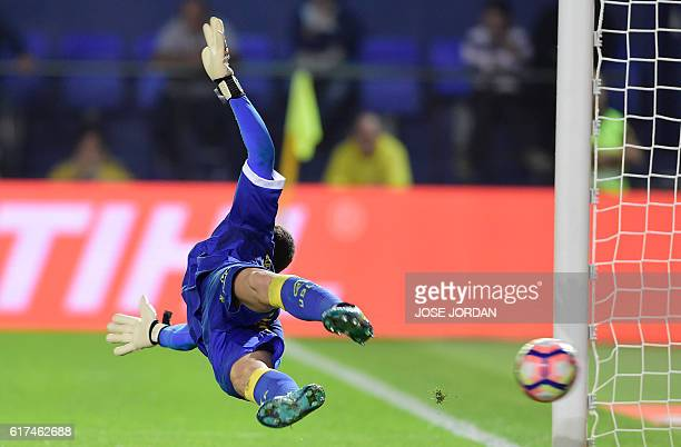 TOPSHOT Las Palmas' goalkeeper Raul Lizoain Cruz concedes a goal after failing to stop a penalty kick during the Spanish league football match...