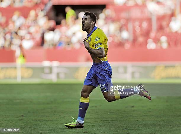 Las Palmas' midfielder Tana Dominguez celebrates after scoring a goal during the Spanish league football match Sevilla FC vs UD Las Palmas at the...