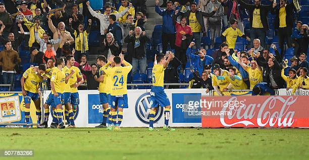 Las Palmas players celebrate a goal during the Spanish league football match UD Las Palmas vs RC Celta de Vigo at the Estadio de Gran Canaria in Las...