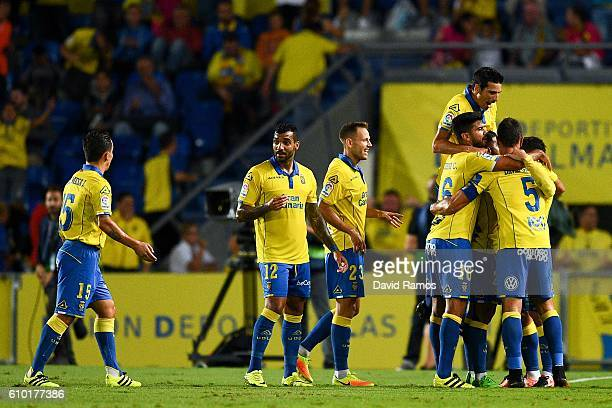 Las Palmas players celebrate after his team mate Tana Dominguez of UD Las Palmas scored his team's first goal during the La Liga match between UD Las...