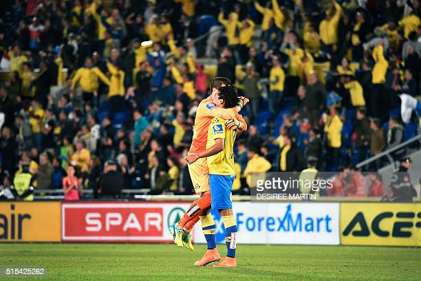 Las Palmas' players celebrate after scoring during the Spanish league football match UD Las Palmas vs Real Madrid CF at the Gran Canaria stadium in...