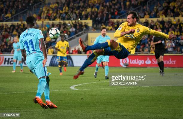 Las Palmas' Uruguayan defender Matias Aguirregaray vies with Barcelona's French midfielder Ousmane Dembele during the Spanish league football match...