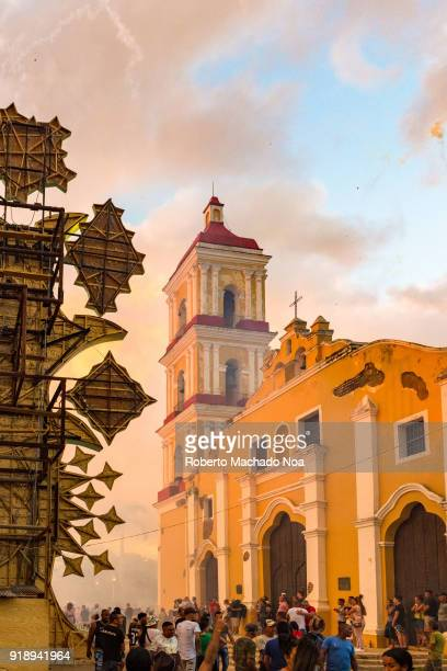 Las Parrandas or Christmas Festival Crowd in front of the colonial Catholic Church named Saint John the Baptist Details of the rear of a Lights...