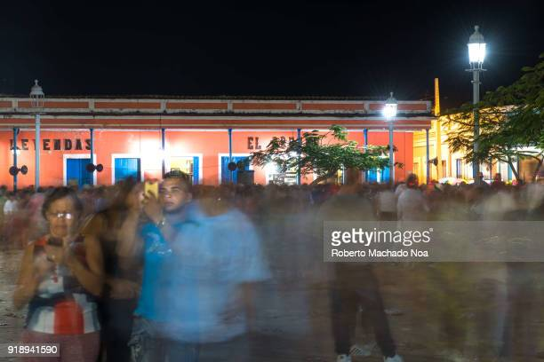 'Las Parrandas' or Christmas Festival crowd moving in the Jose Marti Park 'El Louvre' old building can be seen in the background