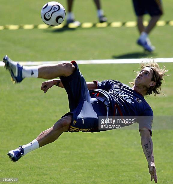 Spanish defender Sergio Ramos goes for an overhead kick during a training session at the Las Rozas sporting complex outside Madrid 24 May 2006 Spain...