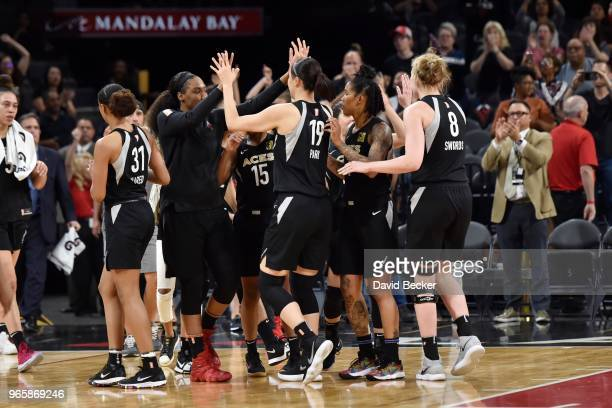 Las Vegas Aces exchange high fives after the game against the Washington Mystics on June 1 2018 at the Mandalay Bay Events Center in Las Vegas Nevada...