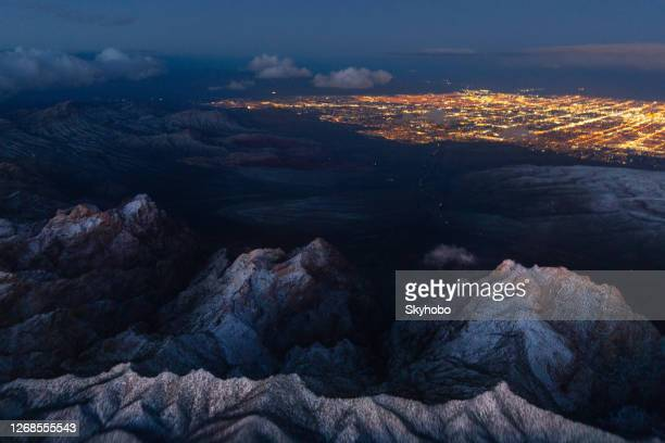 las vegas and the spring mountains with snow - las vegas stock pictures, royalty-free photos & images