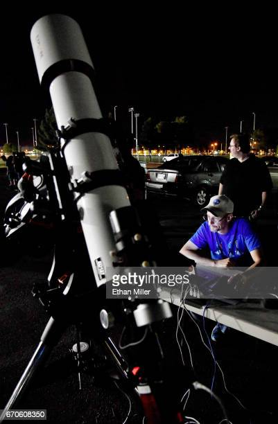 Las Vegas Astronomical Society President Greg McKay looks at a computer screen showing images of asteroid 2014 JO25 from his telescope outside the...