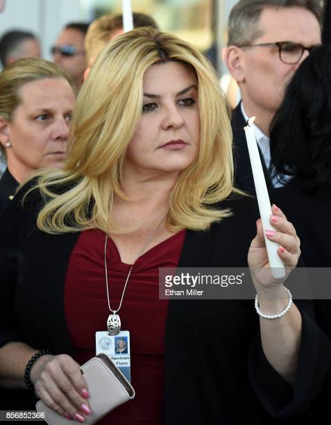 Las Vegas City Councilwoman Michele Fiore holds a candle during a prayer vigil outside Las Vegas City Hall in response to Sunday's mass shooting on...