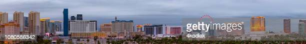 las vegas cityscape panorama on the strip in the evening hour - las vegas boulevard stock pictures, royalty-free photos & images