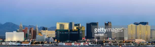 las vegas hotel casino buildings panorama at sunrise - mccarran international airport stock photos and pictures