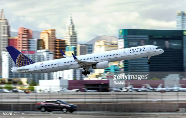 las vegas hotel casino buildings with airplane taking off in the foreground - mccarran international airport stock photos and pictures