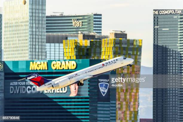 las vegas hotel casino buildings with airplane taking off. - mccarran international airport stock photos and pictures