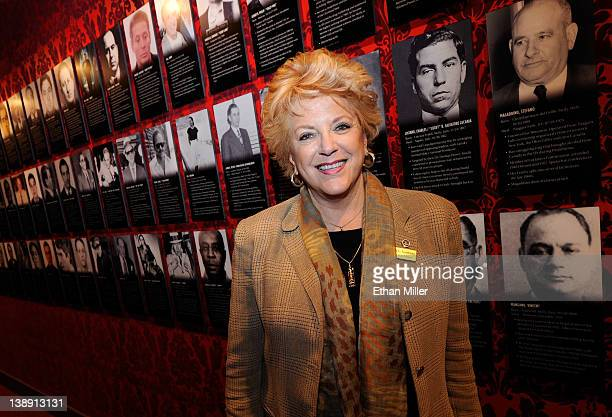 Las Vegas Mayor Carolyn Goodman appears in front of a wall of images of mobsters at The Mob Museum February 13 2012 in Las Vegas Nevada The museum...