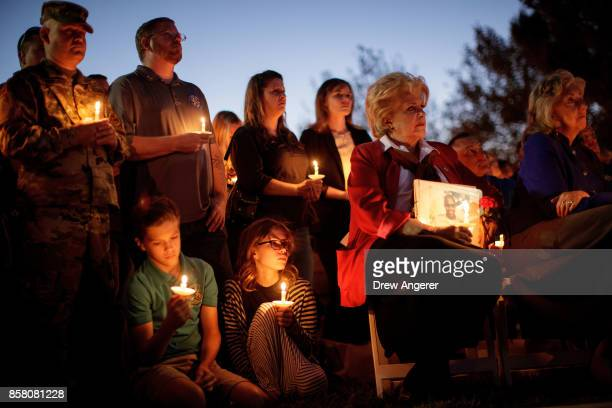 Las Vegas Mayor Carolyn Goodman holds a photo of fallen Las Vegas Metropolitan Police Department Officer Charleston Hartfield during a vigil for him...