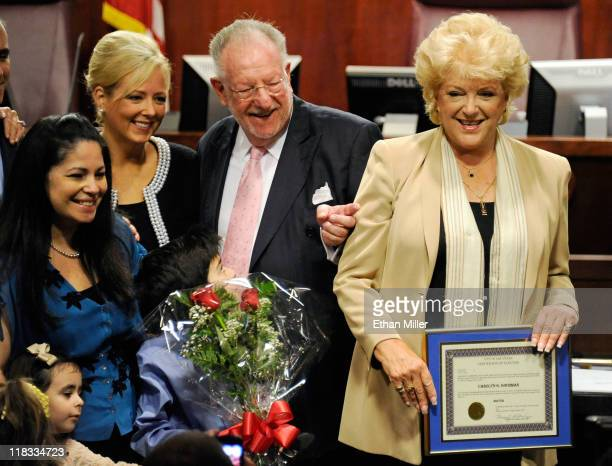 Las Vegas Mayor Carolyn Goodman holds her certificate of election after being sworn in by her husband outgoing Las Vegas Mayor Oscar Goodman at Las...