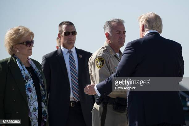 Las Vegas Mayor Carolyn Goodman looks on as Clark County Sheriff Joe Lombardo is greeted by President Donald Trump upon arrival at McCarran...