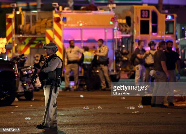 Las Vegas Metropolitan Police Department officer stands in the intersection of Las Vegas Boulevard and Tropicana Ave after a mass shooting at a...