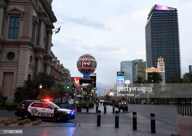 Las Vegas Metropolitan Police Department vehicle is parked at Paris Las Vegas as parts of the Las Vegas Strip go dark as a result of the statewide...