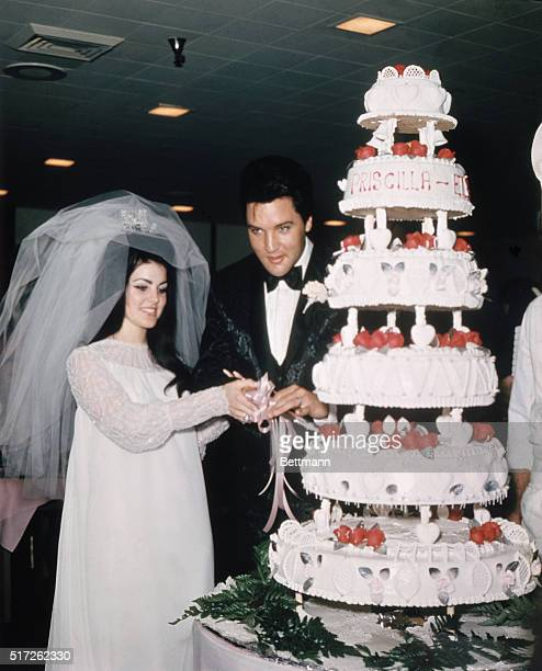 Las Vegas Nevada Entertainer Elvis Presley cuts wedding cake with his bride the former Priscilla Ann Beaulieu May 1 1967