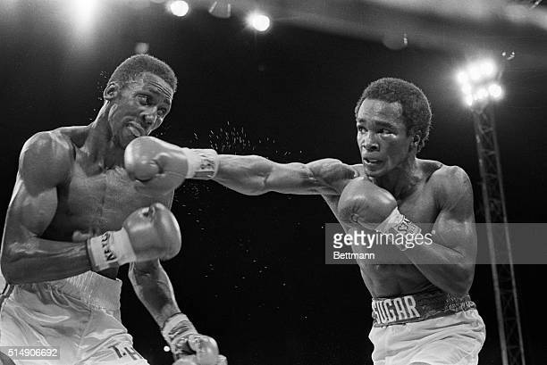 Las Vegas, NV: Welterweight champs Tommy Hearns and Sugar Ray Leonard trade long jabs 9/16. Leonard won the undisputed claim to the title.