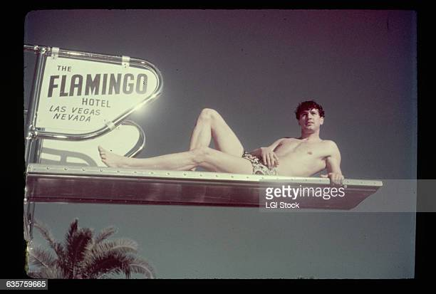 Las Vegas Photo shows Rock Hudson lying sideways on the diving board of the pool at the Flamingo Hotel in Las Vegas Ca 1940s1950s