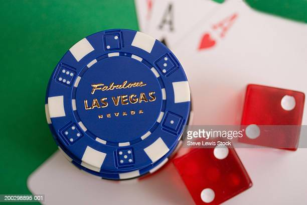 Las Vegas poker chips, dice, and playing cards, close-up