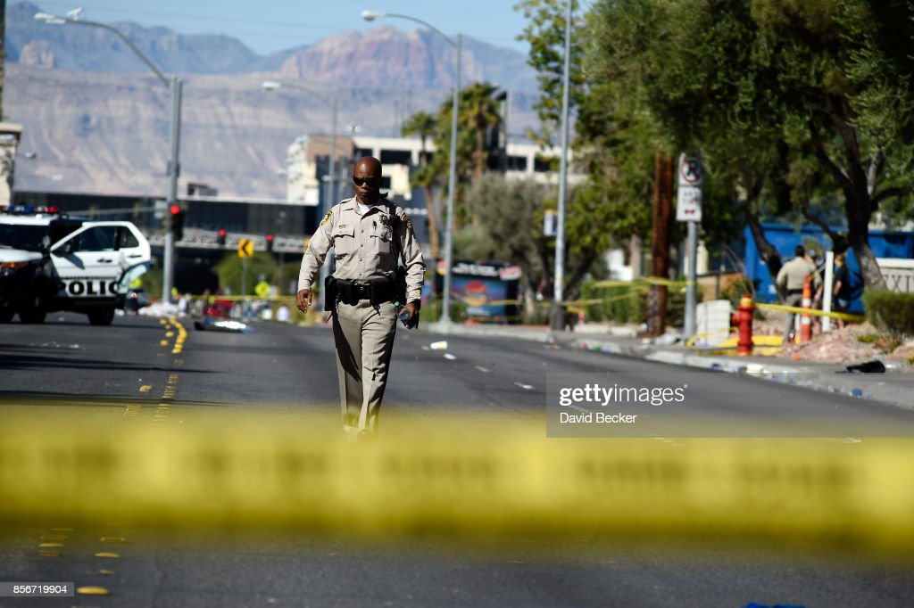 Las Vegas police investigate a side street near the Las Vegas Village after a lone gunman opened fire on the Route 91 Harvest country music festival on October 2, 2017 in Las Vegas, Nevada. The gunman, identified as Stephen Paddock, 64, of Mesquite, Nevada, allegedly opened fire from a room on the 32nd floor of the Mandalay Bay Resort and Casino on the music festival, leaving at least 58 people dead and over 500 injured. According to reports, Paddock killed himself at the scene.
