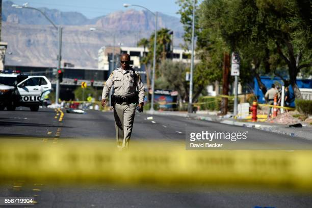 Las Vegas police investigate a side street near the Las Vegas Village after a lone gunman opened fire on the Route 91 Harvest country music festival...