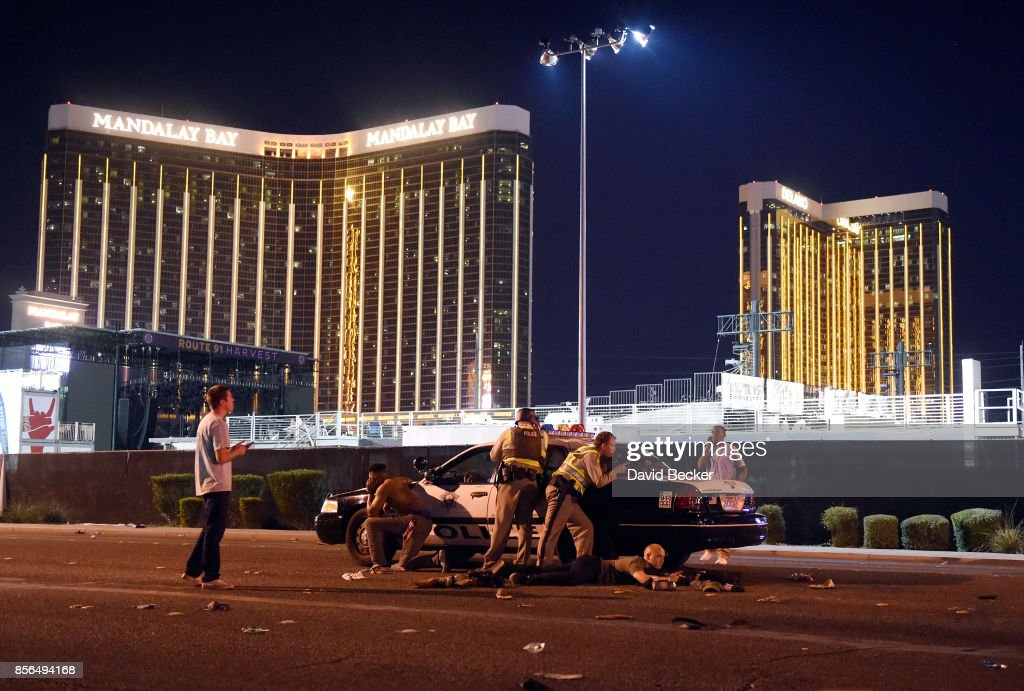 Las Vegas police stand guard along the streets outside the Route 91 Harvest Country music festival groundss of the Route 91 Harvest on October 1, 2017 in Las Vegas, Nevada. There are reports of an active shooter around the Mandalay Bay Resort and Casino.