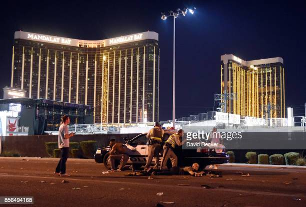 Las Vegas police stand guard along the streets outside the Route 91 Harvest Country music festival groundss of the Route 91 Harvest on October 1 2017...