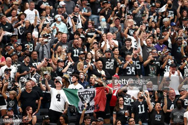 Las Vegas Raiders fans cheer during the game between the Raiders and the Baltimore Ravens at Allegiant Stadium on September 13, 2021 in Las Vegas,...
