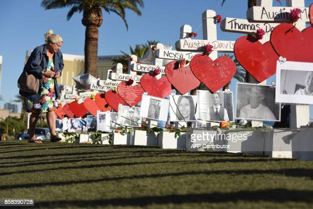 Las Vegas resident Nancy Hardy visits the 58 white crosses for the victims of Sunday night's mass shooting on Las Vegas Strip just south of the...