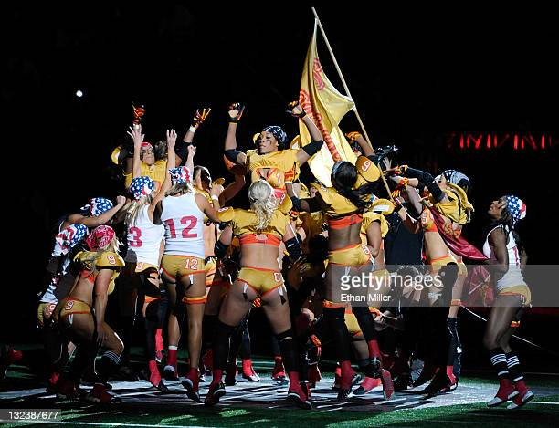 Las Vegas Sin players break out of a huddle on the field before their Lingerie Football League game against the Los Angeles Temptation at the Orleans...