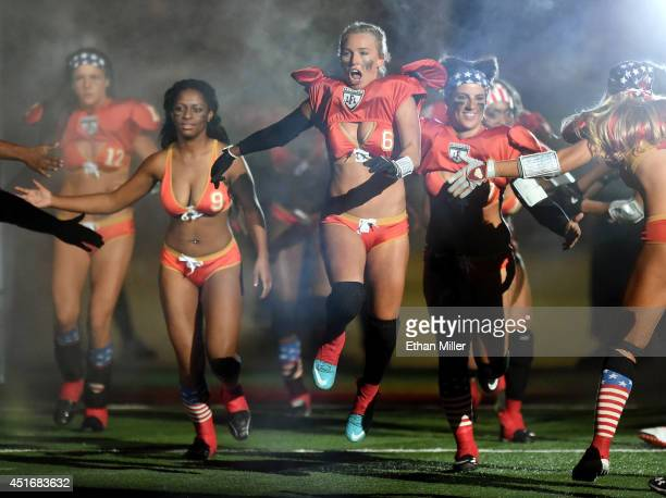Las Vegas Sin players including Markie Henderson run onto the field before the team's game against the Chicago Bliss at the Thomas Mack Center on...