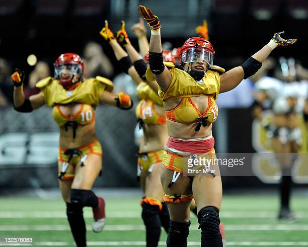 Las Vegas Sin players including Sunshine MisaUli celebrate as time expires in their 2820 Lingerie Football League game victory over the Los Angeles...