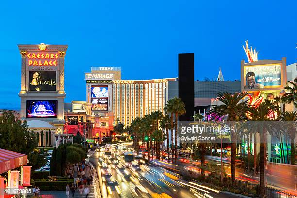 las vegas strip at dusk with hotels and traffic - boulevard stock pictures, royalty-free photos & images