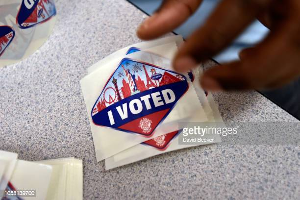 Las Vegas Stripthemed 'I Voted' stickers are displayed at polling station at May Elementary School on November 6 2018 in Las Vegas Nevada Turnout is...