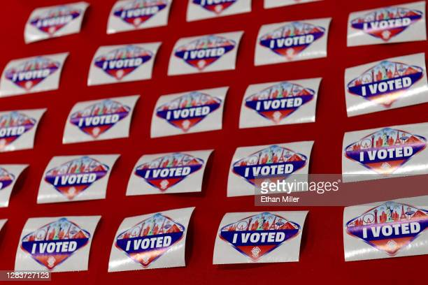 """Las Vegas Strip-themed """"I Voted"""" stickers are placed on a table where voters turn in their activation cards after voting at Desert Breeze Community..."""