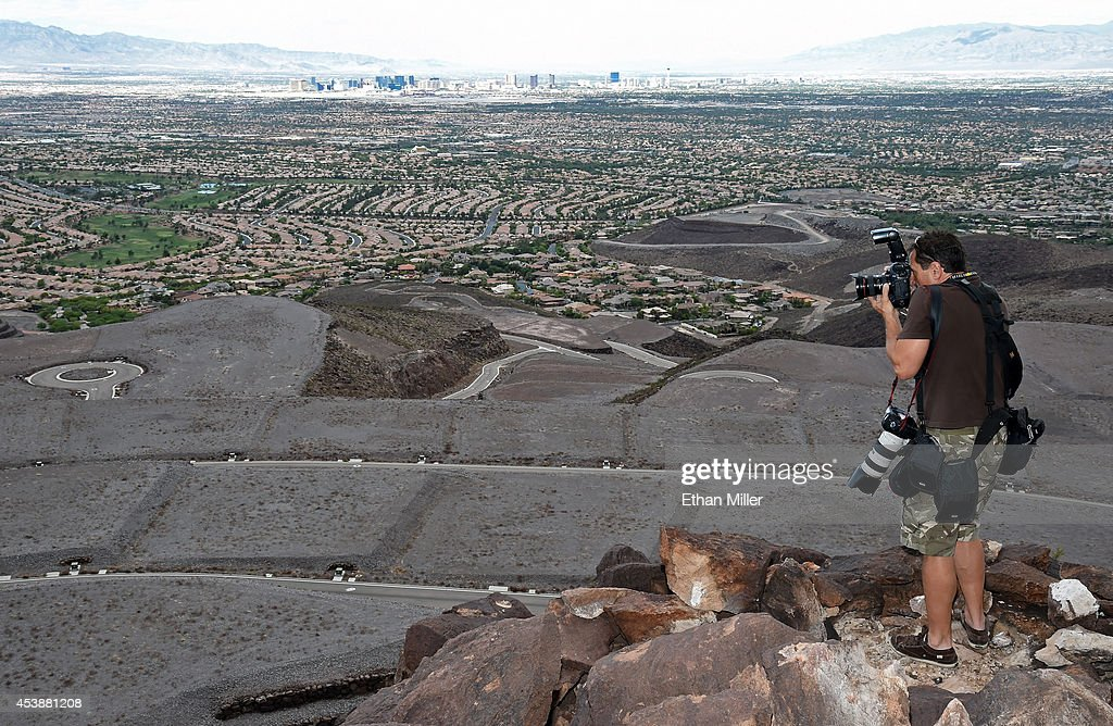 Las Vegas Sun photographer L.E. Baskow takes photos of some of the 313 luxury estate home sites nestled atop the McCullough Range at Ascaya, Nevada's premier luxury home development, on August 20, 2014 in Henderson, Nevada. Ascaya opened its sales center and began accepting reservations on Wednesday.